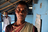 Monika Besra (42) at her house in Danagram a village 40 kms away from Malda Town,  West Bengal, India. 20th August 2010.  Monica Besra says that her non curable tumour got cured on the first annivarsary of Mother Teresa's death by putting a Mother Teressa Medellion on the swollen part of her abdomen, which was recognized by the Vatican in the year 2002 and started the process of Mother Teresa's beatification, a major step towards sainthood.