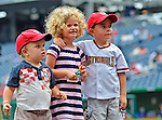 5 September 2011: Three young Washington Nationals fans arrive early to the ballpark before a game against the Los Angeles Dodgers at Nationals Park in Los Angeles, District of Columbia. The Nationals defeated the Dodgers 7-2 in the first game of their 4-game series. Mandatory Credit: Ed Wolfstein Photo