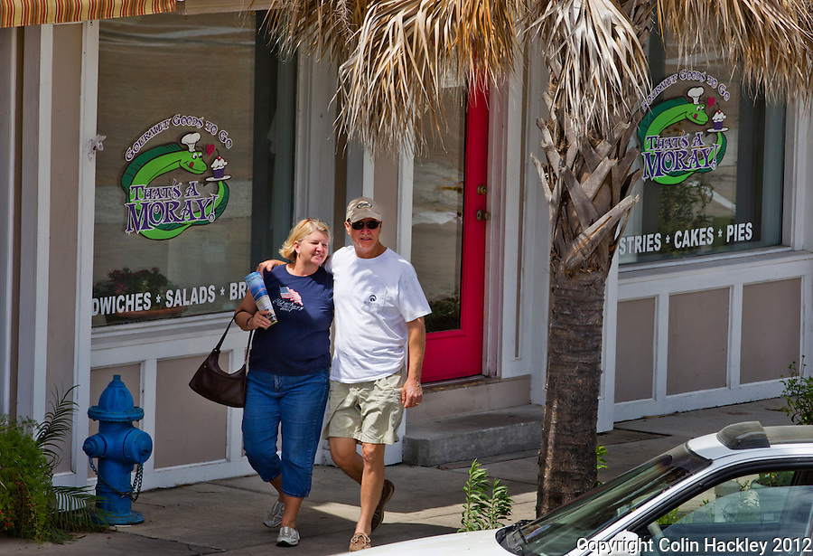 A strolling couple scans downtown Apalachicola for their next stop...COLIN HACKLEY PHOTO