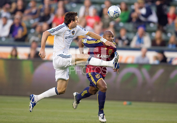 LA Galaxy forward Alan Gordon moves with the ball past Real Salt Lake defender Jamison Olave. Real Salt Lake defeated the LA Galaxy 2-0 at Home Depot Center stadium in Carson, California on Saturday June 13, 2009.   .