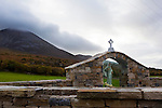 "Statue of the Virgin Mary at the base of Croagh Patrick Mountain, Mayo, in the West of Ireland. An important site of pilgrimage, on Reek Sunday"", the last Sunday in July every year, over 15,000 pilgrims climb it. Croagh Patrick is 764 metres (2,507 ft) high."