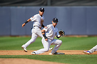 Staten Island Yankees second baseman Jesus Bastidas (2) waits to receive a throw on a stolen base attempt by Lane Milligan (64) as shortstop Eduardo Torrealba (13) backs up the play during a game against the Lowell Spinners on August 22, 2018 at Richmond County Bank Ballpark in Staten Island, New York.  Staten Island defeated Lowell 10-4.  (Mike Janes/Four Seam Images)