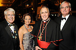 From left: Kevin Doris, Mary Frances Doris, Cardinal Daniel DiNardo and Dennis Mallory at the University of St. Thomas Court of Diamond Jubilee at the HIlton Americas Hotel Tuesday Feb. 16,2010. (Dave Rossman Photo)
