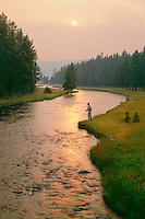 Fly fishing, smokey light from the fires of 1988<br />