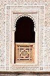 Window with carvings in the Medersa Ben Youssef, Marrakech.
