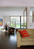 Large glass doors can be shut to separate the living areas without losing any daylight