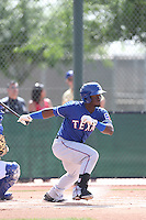 Odubel Herrera #16 of the Texas Rangers bats during a Minor League Spring Training Game against the Kansas City Royals at the Kansas City Royals Spring Training Complex on March 20, 2014 in Surprise, Arizona. (Larry Goren/Four Seam Images)