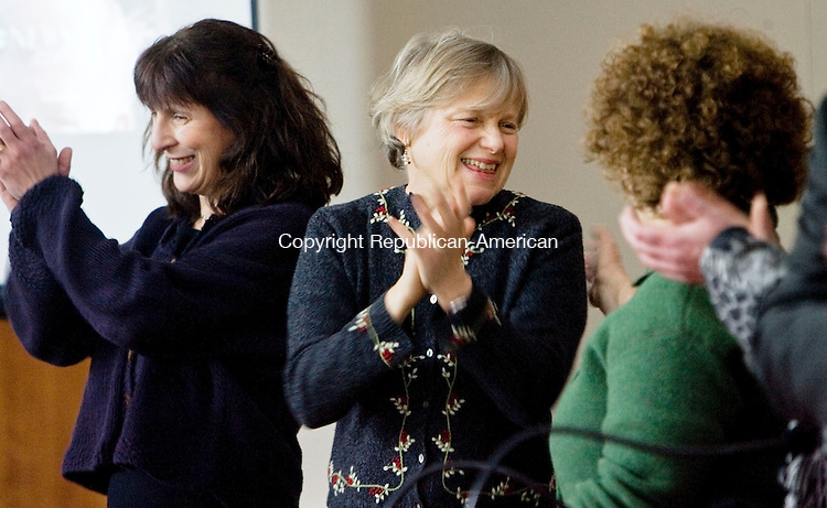 SOUTHBURY, CT - 20 JANUARY 2009 -012009JT04-<br /> FOR COUNTRY LIFE: From left, Julie Clarke, Linda Goodman and Rachel Albert applaud after singing the national anthem at the beginning of a panel discussion and luncheon while watching inaugural events in Washington, D. C. projected on a large screen at the Jewish Federation of Western Connecticut in Southbury on Tuesday.<br /> Josalee Thrift / Republican-American