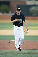 Wake Forest Demon Deacons relief pitcher Garrett Kelly (28) pumps his fist after getting the third out of the inning against the Florida State Seminoles at David F. Couch Ballpark on April 16, 2016 in Winston-Salem, North Carolina.  The Seminoles defeated the Demon Deacons 13-8.  (Brian Westerholt/Four Seam Images)