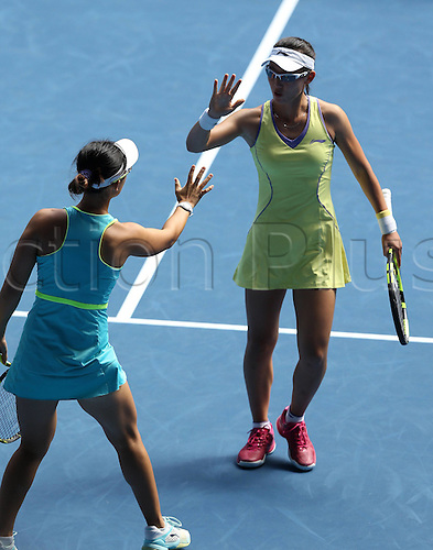 25.01.2016. Melbourne Park, Melbourne, Australia.  Chinas Xu Yifan and Zheng Saisai compete against Hsieh Su-Wei of Chinese Taipei and Georgias Oksana Kalashnikova during the third round match of women s doubles at the Australian Open Tennis Championships in Melbourne, Australia, Jan. 25, 2016. Xu Yifan and Zheng Saisai won the match 6-2, 6-4.