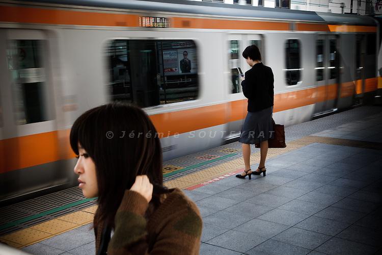 Tokyo, October 25 2011 - In the morning at Shinjuku train station.