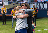 CHICAGO, IL - OCTOBER 6: Jill Ellis of the United States embraces her wife during a game between Korea Republic and USWNT at Soldier Field on October 6, 2019 in Chicago, Illinois.