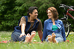 Couple barefoot in meadow with bikes