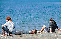 Aberystwyth, Ceredigion, Wales Monday 16th May 2016 UK Weather: People continue to take advantage of the warm weather. Three male students relax and sunbathe on the beach.