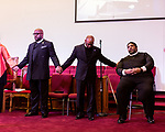 February 10, 2017. Raleigh, North Carolina.<br />  <br /> Rev. Dr. William J. Barber, right,  the president of the North Carolina chapter of the NAACP and the leader of the Moral Mondays movement, waits to take the podium at a pre-HKONJ service at Rush Metropolitan A.M.E. Zion Church.<br /> <br /> On the evening before the annual HKONJ People's Assembly, a civil rights march tied to the Moral Monday movement, religious leaders from around the country gathered at Rush Metropolitan A.M.E. Zion Church to rally their supporters and speak out against nationwide attacks on civil rights and the Trump administration.<br /> <br /> Jeremy M. Lange for The New York Times
