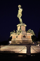 """A night view of a  copy statue  of """" David"""" in  Piazzale Michelangelo Florence."""
