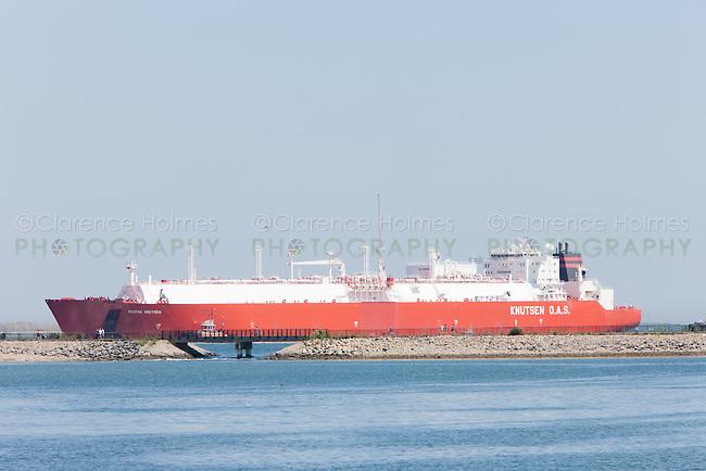 Tanker ship Knutsen O.A.S. entering Boston Harbor passing the Pleasure Bay Loop Trail on Castle Island, Boston, Massachusetts