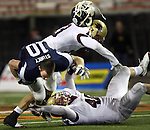 Lake Oswego's Will Storey has his helmet knocked-off of his head by Southridge linebacker D'Cota Fry in the 6A state football championships at Reser Stadium December 6, 2008.
