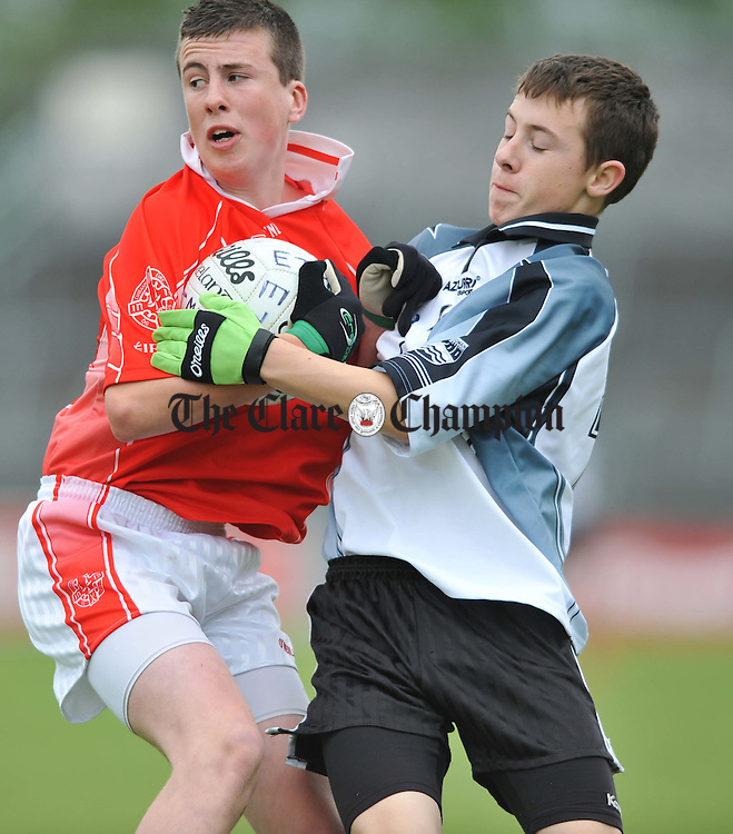 Dara Walsh of Eire Og in action against Conall O hAinifein of Ennistymon during their U-16 Division 1 football final at Cusack Park. Photograph by John Kelly.