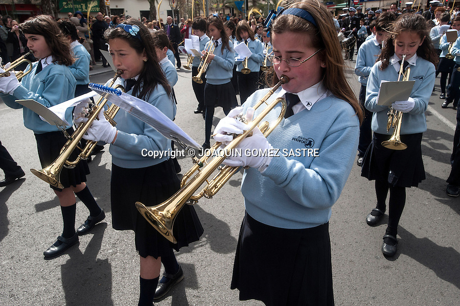 Girls from a school playing trumpet during the procession of Palm sunday.photo © JOAQUIN GOMEZ SASTRE