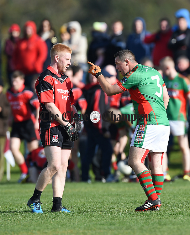 Adam Sherlock of Meelick  and Brendan Moloney of Kilmurry Ibrickane  exchange views during their Junior A  county final at Gurteen. Photograph by John Kelly.