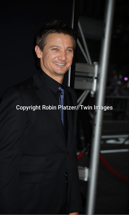 "Jeremy Renner attends the World Premiere of ""The Bourne Legacy"" on July 30, 2012 at The Ziegfeld Theatre in New York City. The movie stars Jeremy Renner, Rachel Weisz, Edward Norton, Stacy Keach, Dennis Boutsikaris and Oscar Isaac."