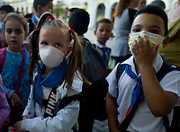 HAVANA, CUBA - March 13:  Two cuban children wear a face mask outside of a school in Old Havana, Cuba, Friday, March 13, 2020,  The World Health Organization declared a global pandemic as the coronavirus rapidly spreads across the world.(Photo by Eliana Aponte/VIEWpress)