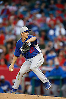 Zack Greinke #21 of the Los Angeles Dodgers pitches against the Los Angeles Angels in both teams final spring training game at Angel Stadium on March 30, 2013 in Anaheim, California. (Larry Goren/Four Seam Images)