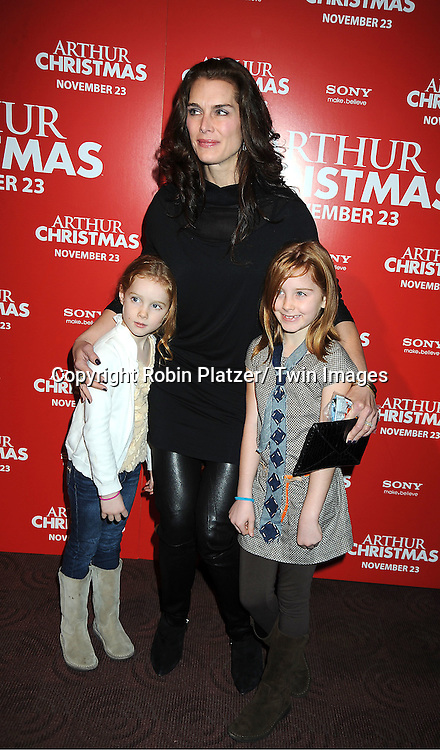 "Brooke Shields and daughters Rowan and Grier posing for photographers at The New York Special Screening of ""Arthur Christmas"" on November 13, 2011 at The Clearview Chelsea Theatre in New York City."