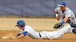 BROOKINGS, SD - APRIL 1:  Eric Danforth from South Dakota State slides into second as Chris Housley #14 from Dakota Wesleyan tries to apply the tag during the Jacks home opener Wednesday afternoon in Brookings. (Photo by Dave Eggen/Inertia)