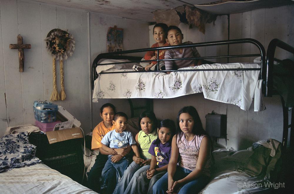 Texas, McAllen, Rio Grande Valley. Migrant workers children. All seven sleep in this one bedroom.