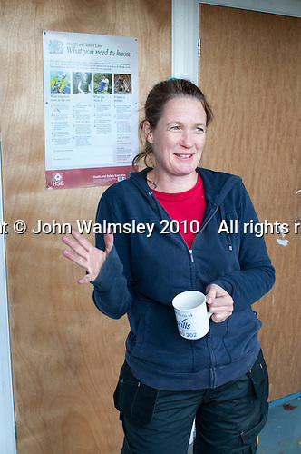 Plumbing student enjoys a hot drink during a break, Able Skills, Dartford, Kent.