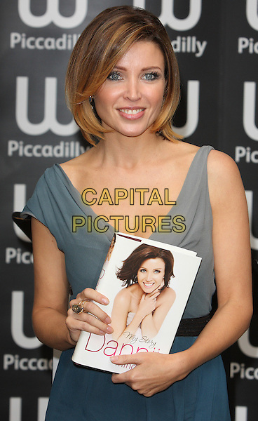DANNII MINOGUE .Signing her book 'Dannii: My Story' at Waterstone's, Piccadilly, London, England..October 29th, 2010 .booksigning half length blue grey gray cowel neck sleeveless highlights hair dress black .CAP/ROS.©Steve Ross/Capital Pictures