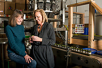 Managing Partners of Higher Standard Packaging Barbara Diner (right) and Deb Baker at the Terrapin Care Station production facility in Aurora, Colorado, Thursday, January 12, 2017. The two women started a business making containers and packaging for cannabis dispensaries and cannabis edibles/concentrates companies, including white plastic canisters made out of recycled milk jugs.<br /> <br /> Photo by Matt Nager