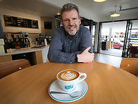 March 20, 2019. San Diego, CA. USA|  Bird Rock Coffee Roasters owner Jeff Taylor with a cappuccino at his coffee shop in Pacific Beach. | Photos by Jamie Scott Lytle. Copyright.