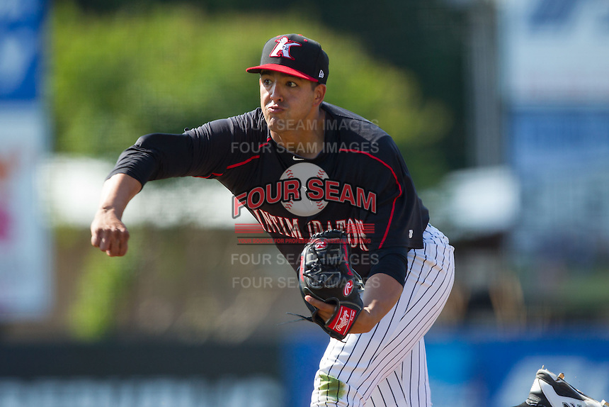 Kannapolis Intimidators starting pitcher Jake Sanchez (33) follows through on his delivery against the Hagerstown Suns at CMC-Northeast Stadium on June 1, 2014 in Kannapolis, North Carolina.  The Intimidators defeated the Suns 5-1 in game one of a double-header.  (Brian Westerholt/Four Seam Images)