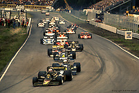 ANDERSTORP, SWEDEN - JUNE 13: Mario Andretti, driving his Lotus 77 R1/Ford Cosworth DFV, leads the field into Turn #1 after the start of the Swedish Grand Prix on June 13, 1976, at the Scandinavian Raceway near Anderstorp, Sweden.