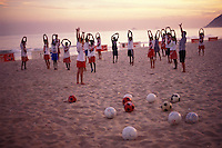 Beach soccer school for children at Ipanema beach, Rio de Janeiro, Brazil.