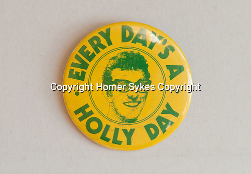 Every Day's a Holly Day badge. Paul McCartney had just bought the Buddy Holly back catalogue, and had a part at the Orangery in Holland Park to celebrate. 1970s?