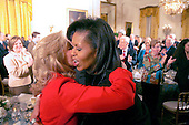 Washington, DC - March 4, 2009 -- First Lady Michelle  Obama hugs Dr. Jill Biden at  a dinner for Congressional  Committee chairmen and ranking members in the East Room of the White House on Wednesday, March 4, 2009..Credit: Dennis Brack - Pool via CNP