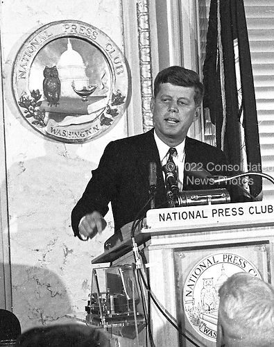 """United States Senator John F. Kennedy (Democrat of Massachusetts), a candidate for the 1960 Democratic Party nomination for President of the United States, speaks at a National Press Club luncheon in Washington, DC on January 14, 1960.<br /> Credit: Benjamin E. """"Gene"""" Forte / CNP"""