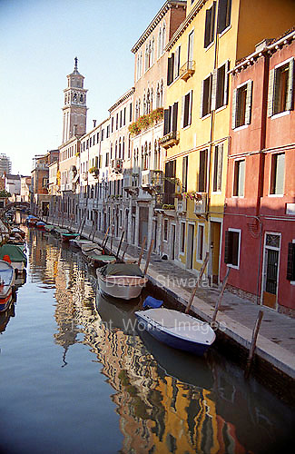 Tranquil Venetian Canal reflects sky light in the afteroon shade in the Siestri Dorsoduro