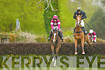 Eventual winner Raithlin and jockey Mark Enright clears the fence ahead of Treacle and jockey DJ Casey during the www.THEMALTON.com chase at Killarney Races on Sunday