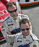 Drivers Darren Law, left, and David Donohue at the Rolex 24 at Daytona, Daytona International Speedway, Daytona Beach, FL, January 2011.  (Photo by Brian Cleary/www.bcpix.com)