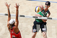 Campionati mondiali di beach volley, Roma, 18 giugno 2011..Germany's Julius Brink, right, spikes the ball against Poland's Mariusz Prudel, during the Beach Volleyball World Championship in Rome, 18 june 2011..UPDATE IMAGES PRESS/Riccardo De Luca