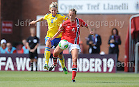 Lina Hurtig of Sweden battles with Carlotta Fennefoss of Norway during the UEFA Womens U19 Championships at Stebonheath park Sunday 25th August 2013. All images are the copyright of Jeff Thomas Photography-www.jaypics.photoshelter.com-07837 386244-Any use of images must be authorised by the copyright owner.