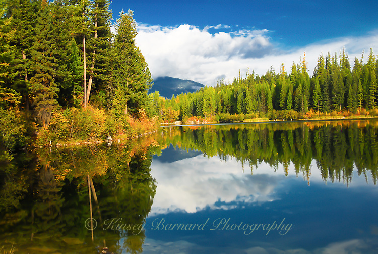Montana blue skies and clouds reflecting on Lion Lake in the Flahead National Forest near Hungry Horse