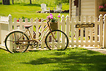 Decorative bike and picket fence in May.