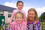 Playing on the new playground at Raheen Montessori Group are Alicia Heapes and Leah Daly with Manager, Lorena O'Connor