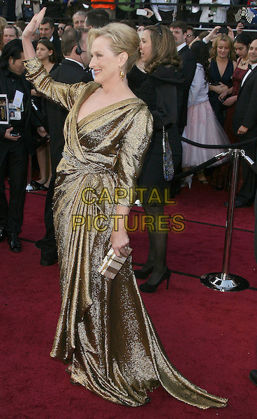 Meryl Streep.84th Annual Academy Awards held at the Hollywood & Highland Center, Hollywood, California, USA..February 26th, 2012.oscars full length gold dress hand arm waving side profile .CAP/ADM.©AdMedia/Capital Pictures.
